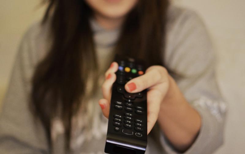 woman-girl-remote-watching.jpg